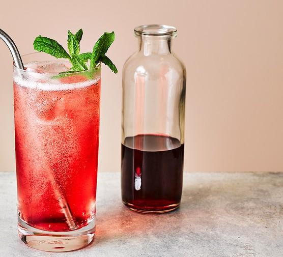 Grenadine with a cocktail alongside