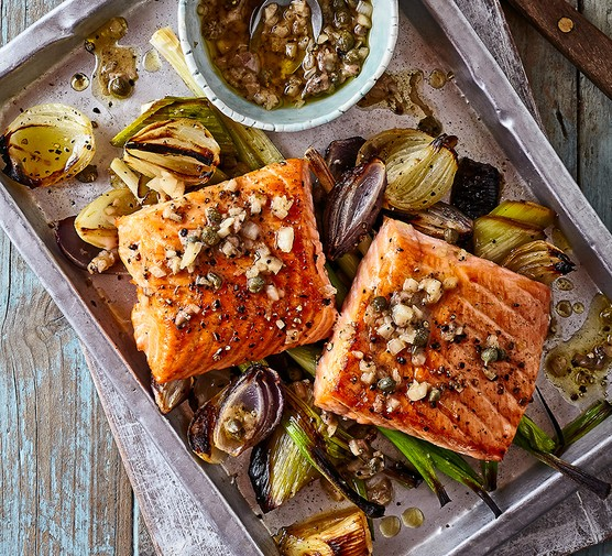 A tray serving roast salmon with leeks, onions & parsley dressing