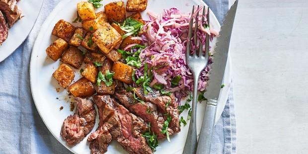 Smoky steak with Cajun potatoes & spicy slaw