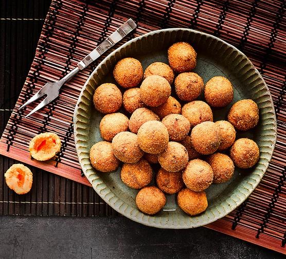 Sweet potato balls served on a large dish