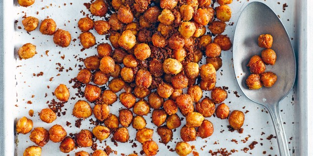 Roasted chickpeas on tray with spices