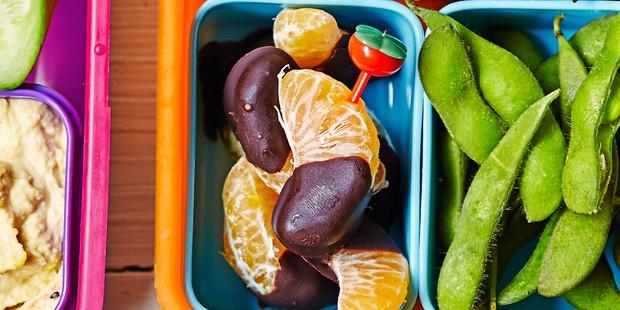 Chocolate-dipped tangerine segments