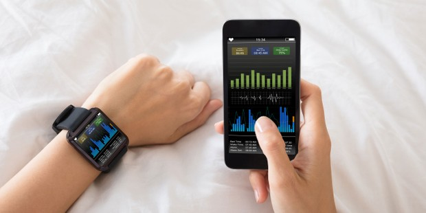 Sleep tracker on a wrist and smart phone screen