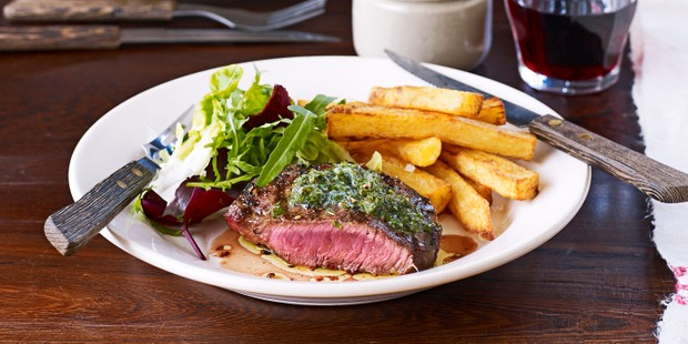 Steak and chips on plate