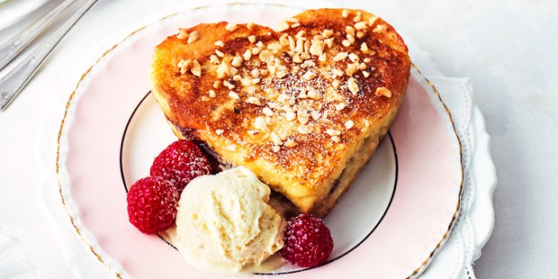 Sweetheart sandwich with ice cream and raspberries on plate