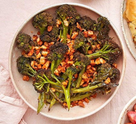 Cumin-roasted broccoli with preserved lemon yogurt served in a bowl