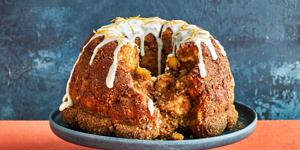 Carrot cake monkey bread wreath topped with drizzle icing and a slice taken out