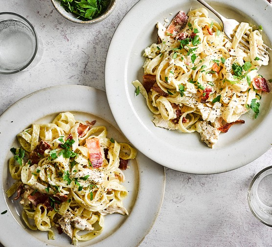 Two bowls of chicken and bacon pasta