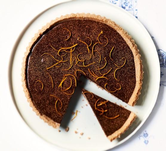 Chocolate orange tart with slice taken out
