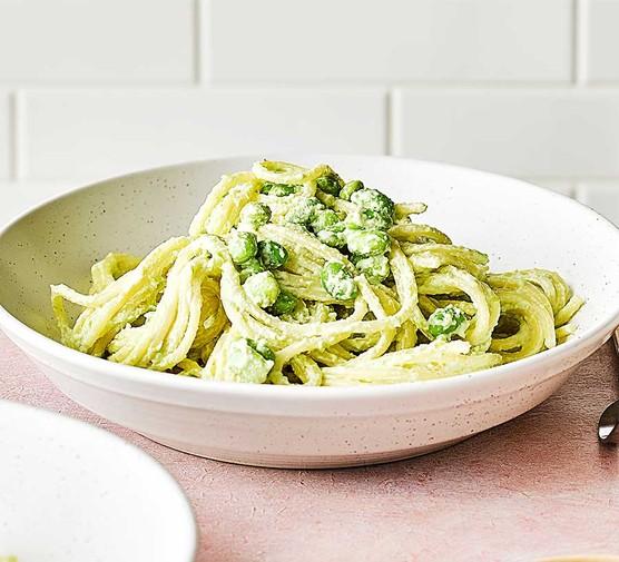 Creamy edamame pesto pasta with rocket salad in a bowl