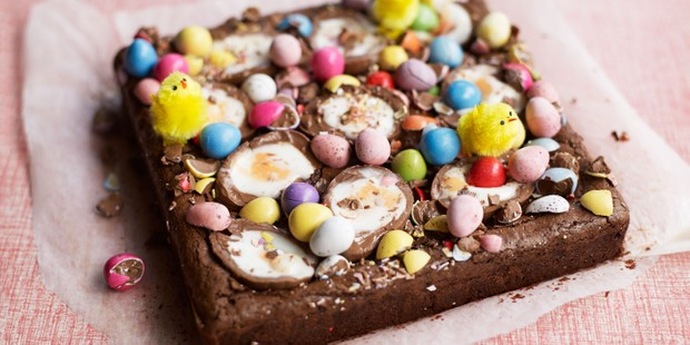 Chocolate brownies topped with Creme Eggs, mini eggs, Easter chickens and sweets
