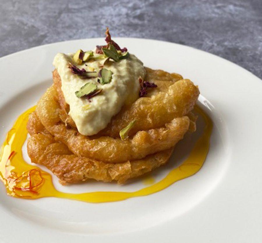 Indian pancakes with saffron & rosewater cream (malpua & rabri)