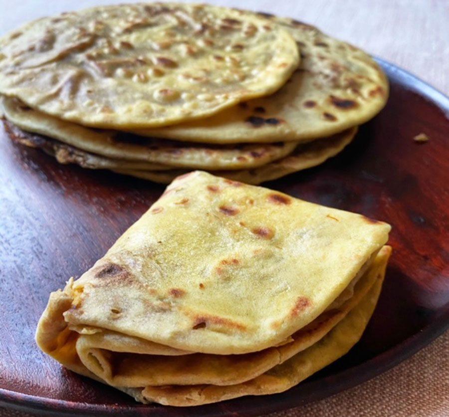 Saffron flatbread filled with lentils & jaggery (puran poli)