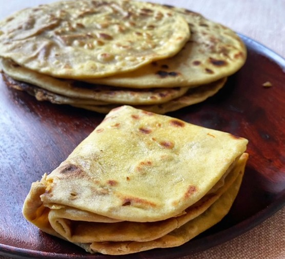 Saffron flatbread filled with lentils and jaggery (puran poli)