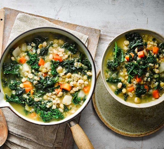 Scotch broth soup in a pan and large bowl