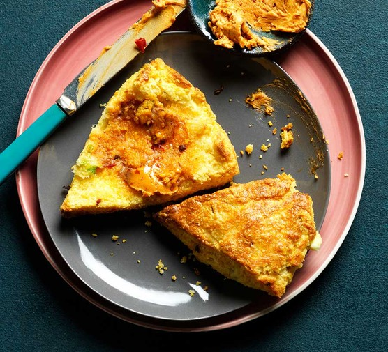 Spring onion & feta cornbread scones with chipotle butter on plates