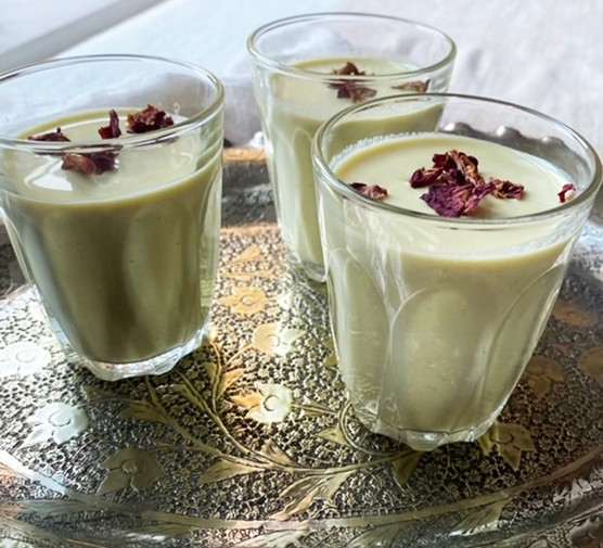 Three glasses serving spiced saffron and rosewater milk (thandai)