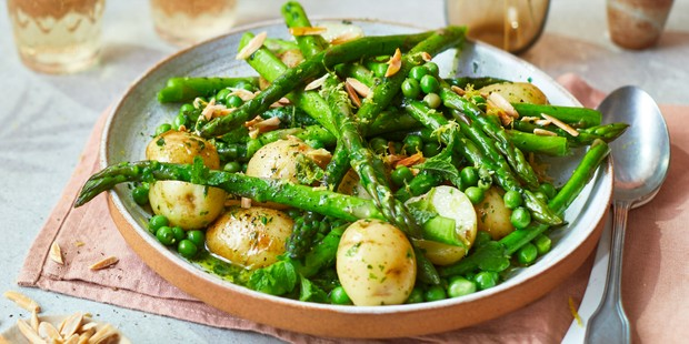 Plate of asparagus with peas, mint & Jersey Royals in wild garlic butter