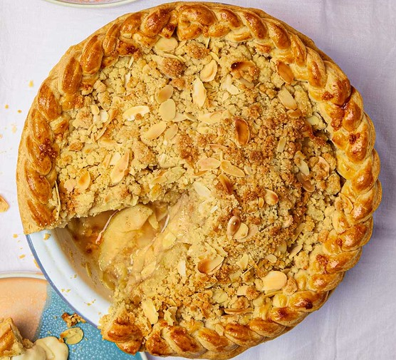 Apple & almond crumble pie with the first slice cut out