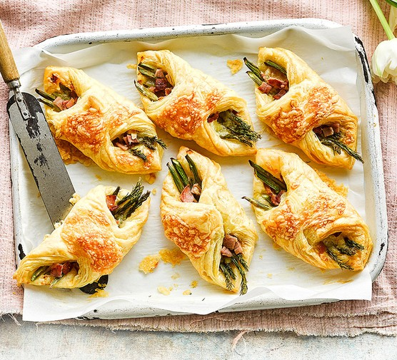 Cheese, bacon & asparagus puffs on a baking tray