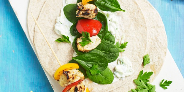 Chicken and vegetables on open tortilla wraps