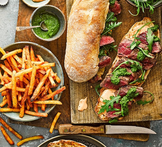 Chimichurri-style steak sarnies & cheat's spicy fries served on the side