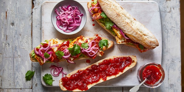 Sliced baguette topped with chorizo jam, halloumi and relish