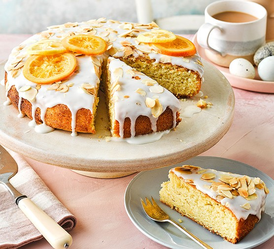 Citrus, almond & yogurt cake on a cake stand