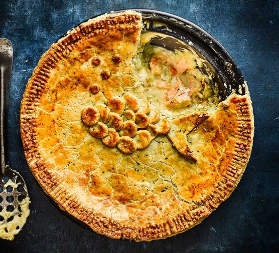 Creamy leek, potato, cheddar & chive fish pie with the first slice cut out