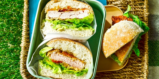 Sandwich baps filled with crispy chicken, avocado and lettuce