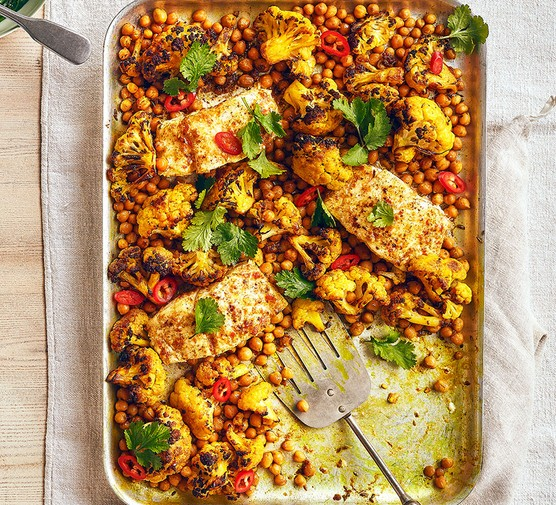 Curried butter-baked cod with cauliflower and chickpeas
