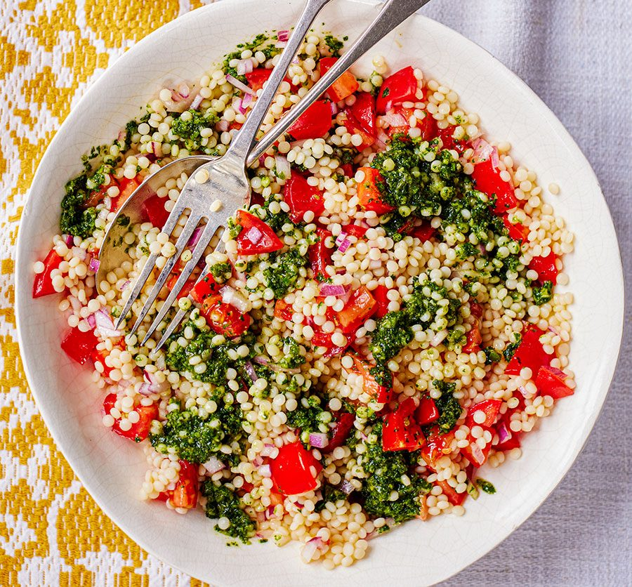 Giant couscous & tomato salad with zhoug-style dressing