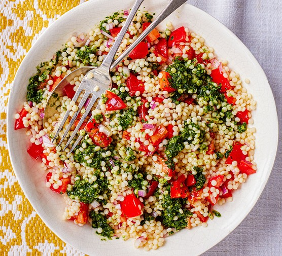 Giant couscous & tomato salad with zhoug-style dressing in a bowl