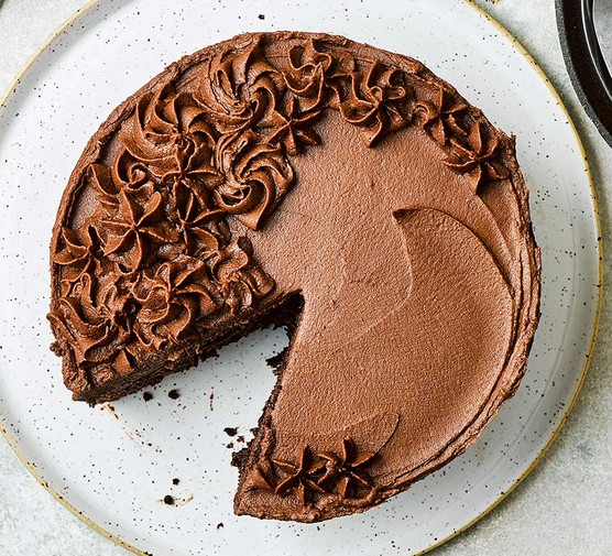 Gluten free chocolate cake with the first slice cut out
