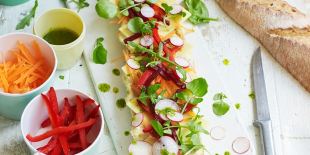Colourful baguette halves topped with vegetables