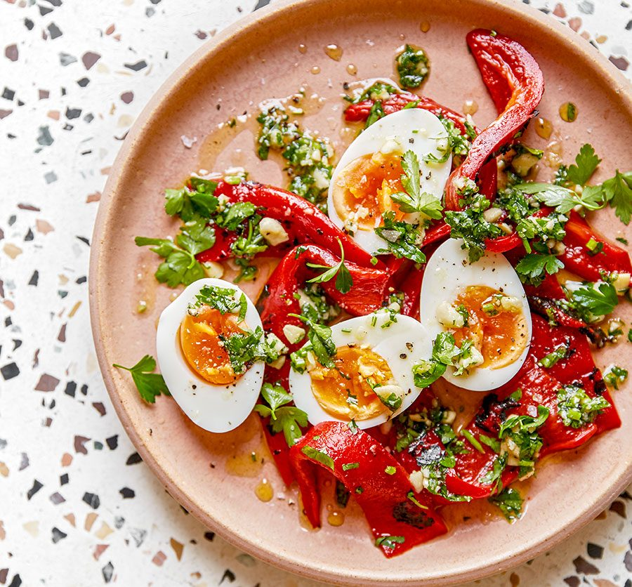 Roast peppers with 'jammy' eggs & almond & parsley dressing