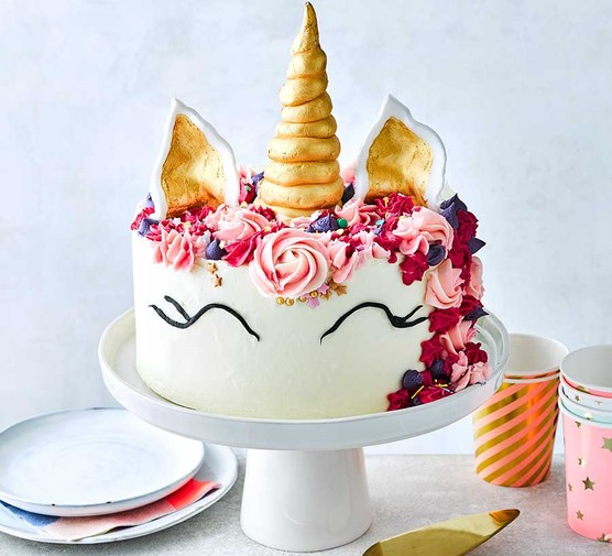 Unicorn-themed cake on a cake stand
