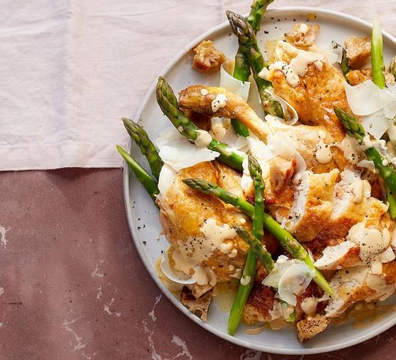 Whole crispy roast chicken & asparagus caesar served on a plate
