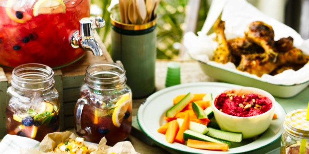 Blueberry iced tea on table with picnic food