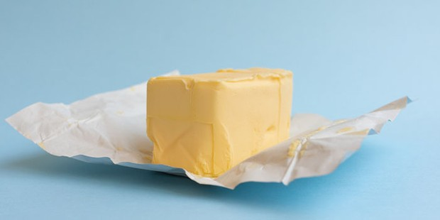 Close-Up Of Butter On Blue Background