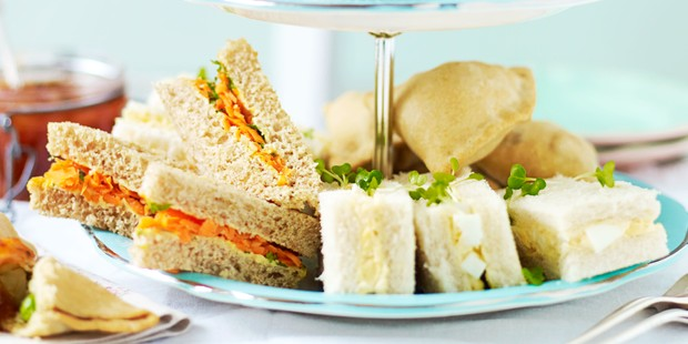 Carrot and raisin sandwiches on stand
