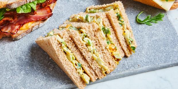 Coronation egg mayo sandwich triangles on board