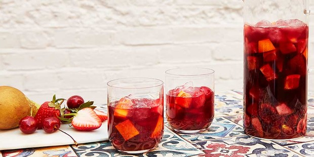 Sangria in glasses with fruit and pitcher