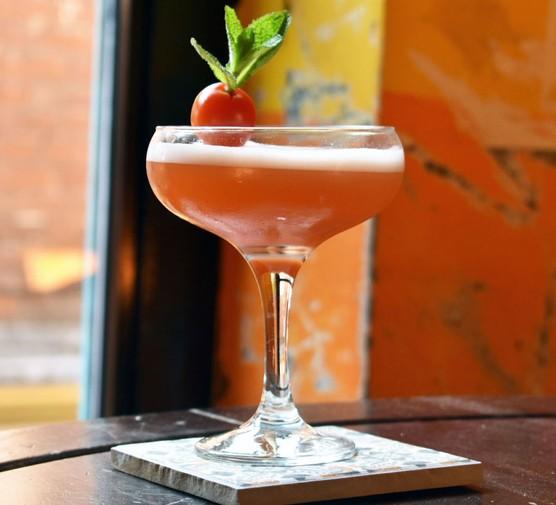 Jessica rabbit cocktail with tomato garnish