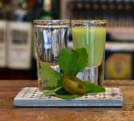 Mezcal and verdita shots on bar