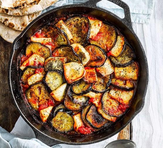 Aubergine, halloumi & harissa bake in a skillet pan