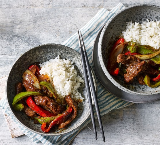 Two bowls of beef in black bean sauce with rice
