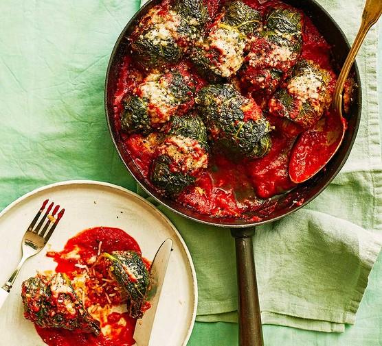 Chorizo-stuffed cabbage rolls in a frying pan