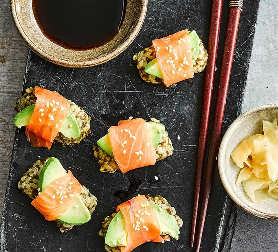 Kelp and smoked salmon sushi-style rolls with soy sauce alongside