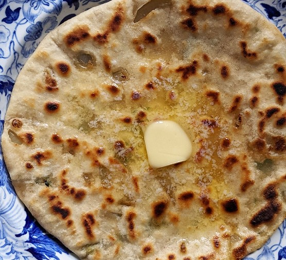 Stuffed paratha with butter